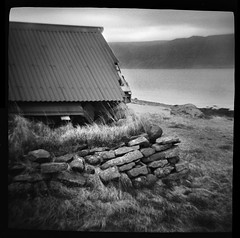 Fjord Hut (Chuck Baker) Tags: alternative analog abandoned architecture blackandwhite building blackwhite believe camera darkroom diana eastman film kodak lomography lomo light monochrome notechography outdoor outdoors ocean photography photograph plastic rural ruins surreal toy trix z