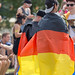 Two men are covered by German flags at Tomorrowlan festival in Belgium