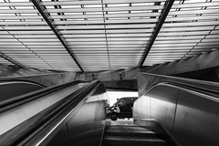 it's watching you!!!!! (Rudy Pilarski) Tags: travel voyage architecture architectura architectural line ligne lisbonne lisbao europe europa monochrome moderne modern nikon nb bw noiretblanc blackandwhite escalator portugal urbain urban urbano form forme perspective
