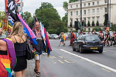 Great Portland Street (Pride) (Spannarama) Tags: pride rainbow colourful greatportlandstreet london uk prideparade woman totebag man flags people crossingtheroad car traffic londonpride pride2019 whistle merch flagseller