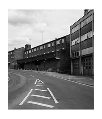 Follow the Signs (Thomas Listl) Tags: thomaslistl blackandwhite biancoenegro noiretblanc monochrome urban city london uk greatbritain england topography architecture greenwich urbanlandscape grey facade 35mm sky road lines contemporarylandscape