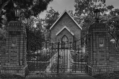 Gateway to Church (Amanda J Richards) Tags: church gate wall trees entrance mono path holy religion history old