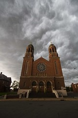 Sacred Heart of Jesus Church (SScheel) Tags: summer storm thunderstorm church architecture arch catholic catholicchurch chippewavalley clouds sunset diocese lacrosse eauclaire heart jesus sky mtsimon nightphotography outdoor parish romanesquerevival romanesque sacredheartchurch sacredheartofjesus shspec stpatricks saint patrick tourism wisconsin westcentralwisconsin cityscape reflections