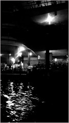 Power remains strong when it remains in the dark; exposed to the sunlight it begins to evaporate. (~Ingeborg~) Tags: meinge amsterdam ij nightlife water reflections underabridge dark phone bicycles darkness