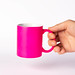 Hand holding pink coffee cup