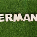 Word Germany on green grass background