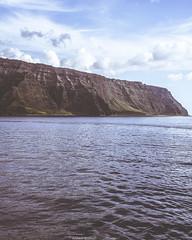 Nā Pali Coast (abridwellphoto) Tags: travel transportation cruise coast coastal ship water hawaii cliffs cliff clouds seascape sea earth sky vintage desaturated nikon