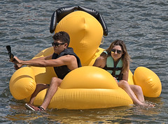 Yellow Duck Ride (Scott 97006) Tags: couple guy man woman female lady inflatable float river water sunshine duck yellow