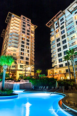 The Luau at Night (craiggonsalves) Tags: sandestin florida emerald coast luau towers pool blue night waterfall vacation low light sky nighttime landscape