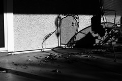 Goodbye (aakeene) Tags: blackandwhite bw outdoor patio chair shadow leaves wall shade