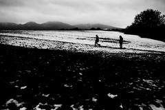 Out In The Fields (Leica M6) (stefankamert) Tags: landscape mountain snow film analogue analog sky people leica m6 leicam6 voigtländer ultron kodak trix stefankamert black noiretblanc noir blackandwhite blackwhite 0219