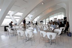 Windhover Coffee (oxfordblues84) Tags: milwaukee wisconsin milwaukeewisconsin artmuseum museum santiagocalatrava milwaukeeartmuseum roadscholarorg roadscholar roadscholartour roadscholartrip architecturalmasterworksoffranklloydwrighttrip quadraccipavilion windhovercoffee people person cafe table chair chairs tables tablesandchairs man men girl girls woman women coffeeshop architecture building interior museuminterior