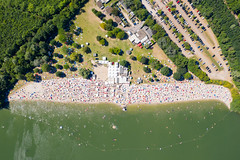 Aerial view of the sandy beach and of the swimming area of Otto-Maigler-See in Hürth, Germany