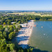 View from the west of the sand beach and swimming area of the lake Otto-Maigler-See in Hürth, Germany