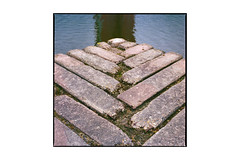 Vierkant eiland in de plas (Hans de Meij) Tags: rotterdam alexander vierkanteilandindeplas monument art water fthadewit hasselblad503cx planar2880cf kodakportra800 epsonv850 120 6x6 concrete