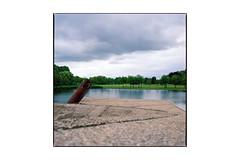 Vierkant eiland in de plas (Hans de Meij) Tags: rotterdam vierkanteilandindeplas monument art sky water fthadewit hasselblad503cx planar2880cf kodakportra800 epsonv850 120 6x6 alexander