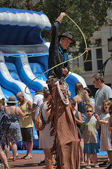 Tall Cowboy (Scott 97006) Tags: man cowboy stilts lasso entertainer hat tall rope outfit character skill talent