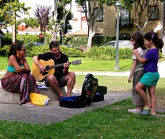 Musician couple and two young girls fans