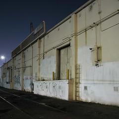 Long wall loading dock (ADMurr) Tags: la dad298 eastside night ladder wall loading dock tracks hasselblad 500cm 50mm zeiss distagon kodak ektar