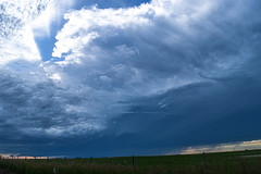 Supercell cloud forming (darletts56) Tags: sky blue cloud clouds field fields crop crops fence white rubbling thunder lightning wind winds windy hail rain sunset saskatchewan canada country dusk evening night orange yellow grey green brown