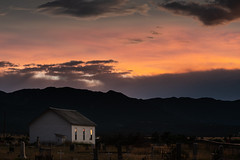 Sunset on New Hope Church - Wetmore, CO (Christopher J May) Tags: co church colorado evening goldenhour graveyard newhopechurch nikonafnikkor80200mmf28d nikond800 sky sunset vivid wetmore cemetery clouds