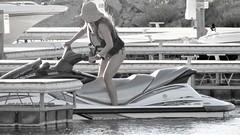 Parking spot (thomasgorman1) Tags: woman pwc watercraft marina recreation travel arizona sunhat lifevest colorado summer water bikini boats monochrome tinted canon