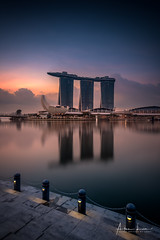 Early Morning At Marina Bay III (Alec Lux) Tags: sands singapore architecture bay blue bluehour building buildings city cityscape exterior facade golden goldenhour haida haidafilters hotel lights longexposure marina night nightscape outdoor outside skyline skyscraper sun sunrise tower urban water