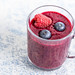 Fresh and healthy Blueberries and Raspberries juice in the glass