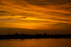 Sunset over St. Pete Beach (subrec) Tags: stpetebeach florida floridasunset orange isledelsol doncesar thedon colorfulskies colorfulsky colorful gulfofmexico water ocean unitedstatesofamerica unitedstates clouds cloudscape sky skyporn boat pentaxk50 pentax pentaxart isladelsol