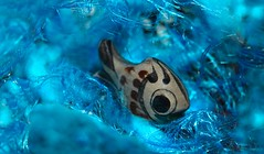 Gone fishing (7 Blue Nights) Tags: gonefishing macromondays macro blue fish smallfigures eye depthoffield smile fun funny happy ceramic animal net