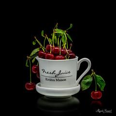 Cherries (Magda Banach) Tags: nikond850 blackbackground cherries colors fruits green leaves macro porcelain red reflection
