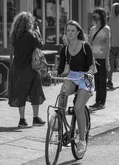 cool blue (Henk Overbeeke Atelier54) Tags: girl street candid bike bicycle bicicletta fiets fahrrad vélo longhair selectivecolor miniskirt earphone