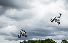 Airborne motorcycles. (CWhatPhotos) Tags: cwhatphotos flickr summer 2019 day photographs photograph pics pictures pic picture image images foto fotos photography artistic that have which contain olympus durham police bikewise bike wise motorcycle motorbikes motorbike fly flying sky clouds stunt kawasaki green bikers