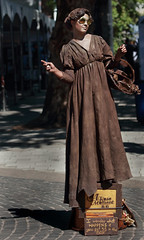 A Rose Moment (Ian Sane) Tags: ian sane images arosemoment bronze human statue busker busking traveler character old town saturday market portland oregon candid street photography performer ankeny square canon eos 5ds r camera ef100400mm f4556l is usm lens