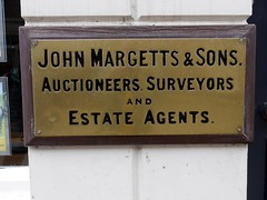 John Margetts & Sons. (the justified sinner) Tags: old sign bronze panasonic 17 20mm brass warwick westmidlands sons gx7 justifiedsinner johnmargett