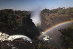 "long exposure view looking west to east along the gorge of Victoria Falls or Mosi-oa-Tunya (The Smoke that Thunders), Zambezi River, Zambia/Zimbabwe, Africa (grumpybaldprof) Tags: ""victoriafalls"" ""mosioatunya"" ""thesmokethatthunders"" waterfall zambia zimbabwe ""davidlivingstone"" zambezi ""zambeziriver"" africa unesco ""wonderoftheworld"" ""worldheritagesite"" ""world'slargestsheetoffallingwater"" rainbow roar spray ""1708mlong"" ""108mhigh"" mist canon 80d ""canon80d"" sigma 1020 1020mm f456 ""sigma1020mmf456dchsm"" ""wideangle"" ultrawide ""fineart"" striking artistic interpretation impressionist stylistic style contrast shadow bright dark black white illuminated mood moody atmosphere atmospheric colour colours ""longexposure"" ""neutraldensity"" nd"