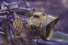 AA8226J (whistlingtent) Tags: aa theaa badge headlight brass bikerally motorbike motorcycle dof depthoffield