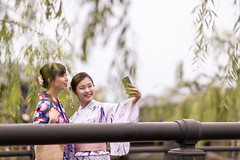 Young female friends in yukata taking selfie picture on bridge (Apricot Cafe) Tags: imgr27733 asia asianandindianethnicities japan japaneseethnicity japaneseculture kimono millennialgeneration sawarakatori bridge carefree chibaprefecture copyspace cultures day enjoyment friendship happiness leisureactivity lifestyles outdoors people photography realpeople selfie sightseeing sky smartphone smiling standing student summer togetherness toothysmile tourism tourist traditionalclothing travel traveldestinations twopeople unescoworldheritagesite waistup willowtree women youngadult youngwomenonly youthculture yukata
