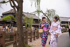 Young female friends in yukata walking in traditional Japanese village (Apricot Cafe) Tags: img130321 asia asianandindianethnicities japan japaneseethnicity japaneseculture kimono millennialgeneration sawarakatori bag buildingexterior carefree chibaprefecture copyspace cultures day enjoyment facetoface friendship happiness leisureactivity lifestyles nature onoriverchibaprefecture outdoors people photography realpeople river sightseeing sky smiling street student summer talking threequarterlength togetherness toothysmile tourism tourist traditionalclothing travel traveldestinations twopeople unescoworldheritagesite walking youngadult youthculture yukata