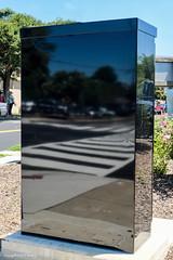 facing forward (Little Hand Images) Tags: rectangle box shiny black electrical reflective facingforward lookingback