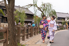 Young female friends in yukata walking in traditional Japanese village (Apricot Cafe) Tags: img130318 asia asianandindianethnicities japan japaneseethnicity japaneseculture kimono millennialgeneration sawarakatori bag buildingexterior carefree chibaprefecture copyspace cultures day friendship fulllengh happiness leisureactivity lifestyles onoriverchibaprefecture outdoors people photography realpeople river sightseeing sky smiling street student summer talking togetherness toothysmile tourism tourist traditionalclothing travel traveldestinations twopeople unescoworldheritagesite walking willowtree youngadult youthculture yukata