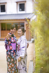 Young female friends in yukata taking selfie picture in public park (Apricot Cafe) Tags: imgr27676 asia asianandindianethnicities japan japaneseethnicity japaneseculture kimono millennialgeneration sawarakatori bamboo buildingexterior carefree chibaprefecture cultures day friendship green happiness leisureactivity lifestyles nature outdoors people photographing photography publicpark realpeople selfie sightseeing smartphone smiling standing student summer threequarterlength togetherness toothysmile tourism tourist traditionalclothing travel traveldestinations twopeople unescoworldheritagesite youngadult youthculture yukata