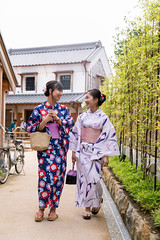 Young female friends in yukata walking in traditional Japanese city (Apricot Cafe) Tags: img130311 asia asianandindianethnicities japan japaneseethnicity japaneseculture kimono millennialgeneration sawarakatori bag bamboo buildingexterior carefree chibaprefecture copyspace cultures day facetoface friendship happiness leisureactivity lifestyles nature outdoors people photography realpeople relaxing sightseeing sky smiling student summer talking togetherness toothysmile tourism tourist traditionalclothing travel traveldestinations twopeople unescoworldheritagesite walking women youngadult youngwomenonly youthculture yukata
