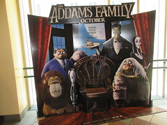 The Addams Family - Wobbly Character Animation Standee 6189 (Brechtbug) Tags: 2019 the addams family computer generated animated cartoon l r gomez uncle fester wednesday thing platter morticia lurch pugsley grand mama inspired by charles chas sure its best character design cartoonist eccentric holiday evil creature monster frankenstein like valet servant retainer manservant nanny domestic portrait nyc july new york city 12th 07212019 animation poster theater theatre