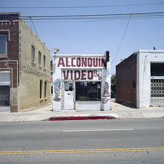 alconquin video. los angeles, ca. 2009. (eyetwist) Tags: eyetwistkevinballuff 6x6 mamiya film store losangeles dvd video kodak small tiny storefront 160vc portra dtla 75mm eyetwist 6mf alconquinvideo california urban building 120 analog mediumformat square la los downtown angeles ishootfilm sidewalk socal analogue mamiya6 streetscape kodakportra160vc emulsion primes angeleno lenstagger mamiya6mf ishootkodak epsonv750pro aicolor filmexif mamiya75mmf35l alconquin mariachi gone cesarchavez boyleheights tape vhs