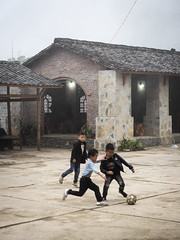 Ha Giang 09 (arsamie) Tags: ha giang vietnam north football sport children play kids school boys skills dribble village town place square bad weather rain clouds soccer asia