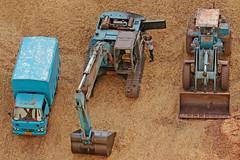 Heavy Equipment Repair - Goa, India (TravelsWithDan) Tags: outdoors heavyequipment steamshovel fromabove man sand repair working goa india city urban blue candid canong3x