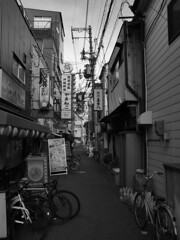 follow the signs and the wires (peaceblaster9) Tags: street alley backstreet signs wires city osaka ストリート 路地 看板 電線 町 町中 大阪 blackandwhite bnw bw blackwhite monochrome モノクローム モノクロ 白黒