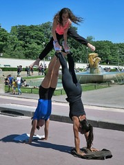 Three young girls performing gymnastic exercises (pivapao's citylife flavors) Tags: paris france trocadero girl sport streetartist