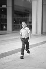 Run Isa, run! (afiskandar) Tags: child son dof bokeh nikond3 nikon100mmf28seriese prime lens natural lighting portrait fun time bw blankandwhite bnw manual focus malaysian boy malay